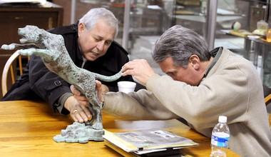 "Lou ""Mr. Easton"" Ferrone, left, helps auctioneer Richard Dotta find the casting number on a copper Lafayette Leopard to be auctioned off in winter 2010. Along with the 1700s map of Easton, this statue is one of a handful of what Ferrone called the ""crown jewels"" of the collection he sold, (Lehighvalleylive.com file photo)"