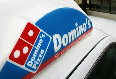 A Domino's Pizza delivery vehicle is seen Feb. 11, 2007. A 30-year-old Easton man was arrested Thursday, Feb. 16, 2017, in the robbery of a Domino's driver after he initially feigned surprise at a gunman, who had interrupted their transaction, and ran off, according to police. (AP file photo   For lehighvalleylive.com)