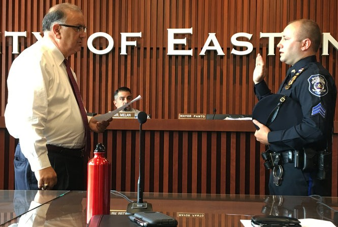 Easton Mayor Sal Panto Jr. swears-in new night shift supervisor Sgt. Ryan Boorstein during the Aug. 8, 2018, meeting of city council. (Kurt Bresswein | For lehighvalleylive.com)
