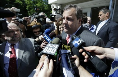 Gov. Chris Christie talks to the press after casting his primary election vote Tuesday.