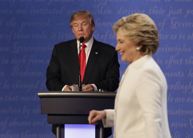 Republican presidential nominee Donald Trump waits behind his podium as Democratic presidential nominee Hillary Clinton makes her way off the stage following the third presidential debate, Oct. 19, 2016, at UNLV in Las Vegas. (AP file photo | For lehighvalleylive.com)