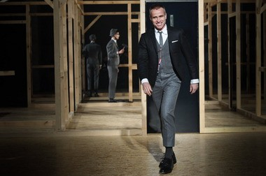 American fashion designer Thom Browne greets the audience Sunday during his Fall-Winter 2013/2014 Men's Fashion Collection presentation in Paris. His design was selected by Michelle Obama for her inauguration outfit.