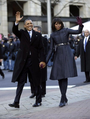 President Barack Obama and first lady Michelle Obama wave as they walk down Pennsylvania Avenue during the 57th Presidential Inauguration parade Monday in Washington, D.C.