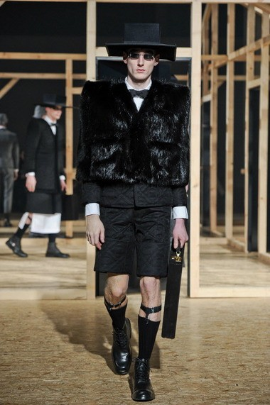 A model wears a creation by American fashion designer Thom Browne Sunday as part of his Fall-Winter 2013/2014 Men's Fashion Collection in Paris.