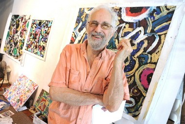 Artist Jay Milder poses in front of his paintings in his studio at Bullseye Art in Easton. Milder and Bill Barrell bought the building, the former warehouse for Easton filmmaker Lou Reda, in 2002.