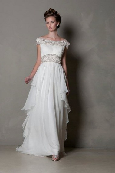 """Bethlehem's own Eugenia Couture bridal design company shares its favorite dress styles for the season. """"Penelope"""" features a shirred silk satin chiffon dress with cascading chiffon panels on an a-line skirt. Cost $4,500."""