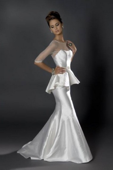A silk Mikado fit n' flair dress with illusion neckline comes with a detachable peplum and detachable organza train. Cost: $3,300, peplum $625, train $875.