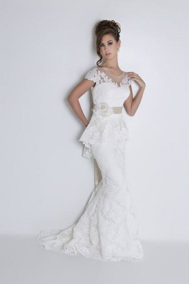 This re-embroidered lace fit n' flair dress features a lace peplum and crochet flower sash. Cost: $3,400, sash is $375.