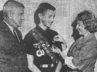 """Sept. 28, 1964: """"New Eagle -- Elmer Morgan, left, of the Boy Scout Council, conducts the Eagle Award ceremony for Robert P. Grow Jr., center, at St. Jane Frances de Chantal Catholic Church last night as Mrs. Grow examines the medal. The new Eagle Scout, 15-year-old son of Mr. and Mrs. Robert P. Grow, 4725 Henry St., is a 10th grade pupil at Notre Dame High School. He is a member of Boy Scout Troop 24 at St. Jane's and became an Explorer last year."""""""