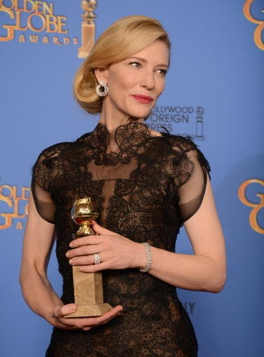 """Cate Blanchett poses in the press room with the award for best actress in a motion picture - drama for """"Blue Jasmine"""" at the 71st annual Golden Globe Awards."""