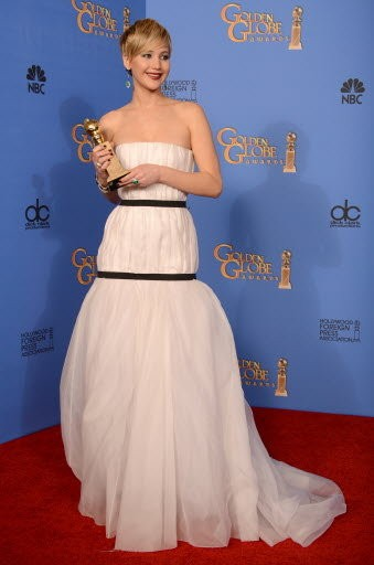 """Jennifer Lawrence poses in the press room with the award for best supporting actress for """"American Hustle"""" at the 71st annual Golden Globe Awards."""