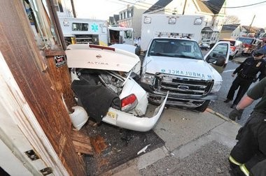 Police and others tend the scene of this two-vehicle crash at Chamber and Hudson streets March 7, 2011, that involved a Phillipsburg Emergency Squad ambulance.