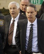 Former Penn State University assistant football coach Jerry Sandusky, left, walks with his attorney Joe Amendola, right, as he leaves the Centre County Courthouse after waiving a preliminary hearing in 2011.