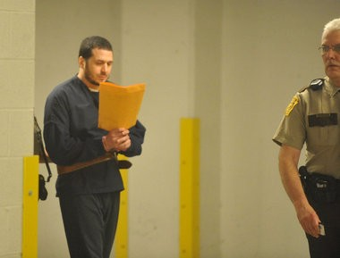 Jose Santiago, seen here being led to court on April 17, 2015, pleaded guilty Monday to a gruesome hit-and-run crash on Airport Road that left a victim dismembered. (Lehighvalleylive.com file photo)