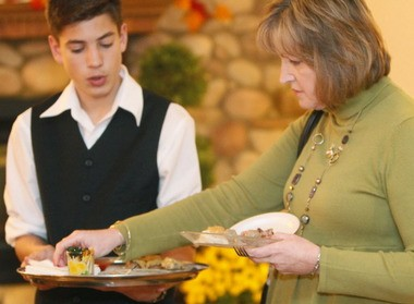 Marlene Hendricks, of Allentown, samples appetizers from Jake Lohman, of Lower Saucon Township, during a mock wedding at The Meadows in Hellertown in November.