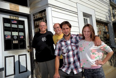 Co-owners Joe and John Fencz met with regulars Michael Frank and Jena Ardell in hopes of reopening the kitchen in Charlie's Pool Room in Alpha.