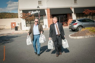 Judith Adele Agentis Charitable Foundation Founder Bob Agentis, left, and Scott Craver, Head Coach, of Shula's Steak House, leave the Upper Saucon Township restaurant with hospice meal donations in hand.