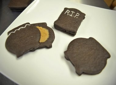Chocolate Pinata cookies can hold candy or peanut butter buttercream frosting in the middle of a triple cookie sandwich.