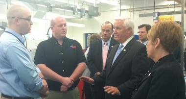 Gov. Tom Corbett speaks with LCTI staff during a toured the school's Precision Machine Tool Technology lab.