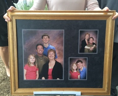 Cheryl Silvonek's family displayed this collage of photos at the sentencing of her killer, Caleb Barnes. Pictured is Cheryl Silvonek, her husband David, and their two kids, Jamie and Alex. Jamie Silvonek pleaded guilty for her role in her mother's killing. (Sarah Cassi | lehighvalleylive.com)