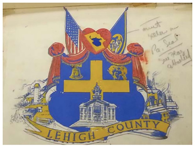 "This is the original print of the Lehigh County Seal adopted by the board of commissioners Dec. 28, 1944, featuring a ""huge cross in canary-yellow"" signifying ""Christianity and the God-fearing people which are the foundation and backbone of (Lehigh) County,"" according to a Sept. 28, 2017, ruling in federal court that the Christian meaning is unconstitutional. (Courtesy image 