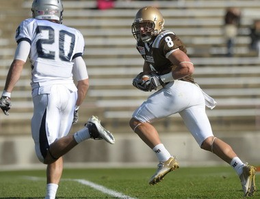Georgetown defensive back David Quintero (#20) defends Lehigh wide receiver Ryan Spadola (#8) as he runs with the ball during a Patriot League football contest at Goodman Stadium.