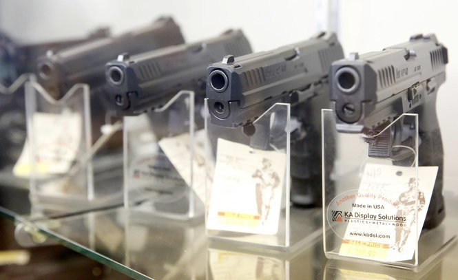 Handguns are displayed for sale March 31, 2016, at a store in Jersey City. Federal law prohibits firearms sales to users of marijuana, including those with medical prescriptions, authorities say. (NJ Advance Media file photo | For lehighvalleylive.com)