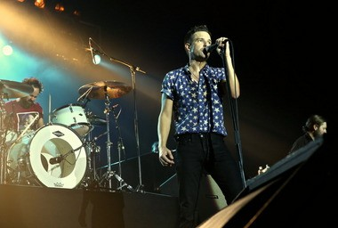 Singer Brandon Flowers and drummer Ronnie Vannucci Jr., of The Killers, perform during the band's May stop in Bethlehem.