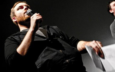 Comedian Ryan Hill, of Bethlehem, performs on stage.