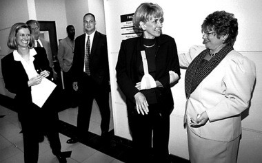 """Then-Lehigh County Executive Jane Baker center is greeted by her secretary, Dorene Darabaris of Bethlehem, in the hallway after apress conference. """"My career really started in Muhlenberg Elementary School,"""" Baker said. """"I was president of the school in fifth grade."""""""