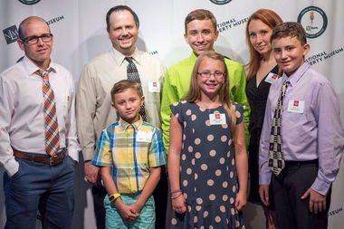 Bethany is surrounded by her family -- mom Rachel, dad Kraig, and brothers Cade, Connor and Lincoln, and her teacher Scott Kopec. (Courtesy photo)
