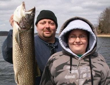 Shawn Dornblaser, left, and Justin Dornblaser of Phillipsburg with the 8-pound lake trout they caught from Merrill Creek Reservoir in April.
