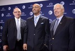 Penn State's new football coach James Franklin, center, poses with athletic director Dave Joyner, left, and Penn State president Rodney Erickson, right.