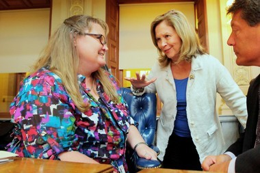 Jennie Stormes of Hope Township, left, talks with Assemblywoman Linda Stender (D-Union) and Assemblyman John Mckeon (D-Essex) in September 2013 after a bill Stender co-sponsored allowing medical marijuana to be dispensed to minors passed at the Statehouse. Stormes said she's moving to Colorado later this month so her son, 15-year-old Jackson, can receive the medical marijuana treatment he needs to control his seizures.