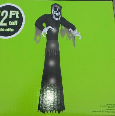 """A 12-foot tall """"Giant Reaper"""" was also stolen overnight Tuesday from a second home, police said."""