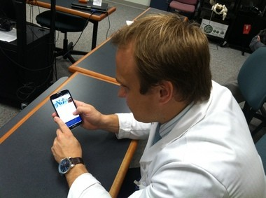 In this November 2013 photo, Christopher Eicher, a third-year resident doctor, looks at New Jersey's prescription monitoring program on his smartphone. Advocates say increased use of the program by doctors and pharmacists could help reduce prescription drug abuse.