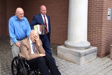 Former Warren County Sheriff Edward Bullock, in the wheelchair, leaves court in Hunterdon County in June 2015 with his attorney, Brian Corley White. The 86-year-old died Monday. (Steve Novak | lehighvalleylive.com file photo)