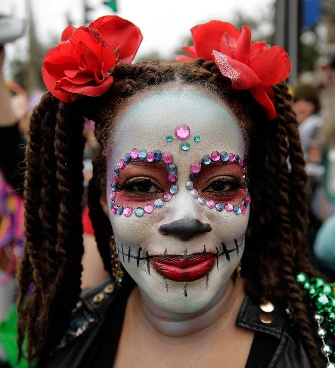 A reveler at the Krewe of Orpheus parade in New Orleans. (Photo by David Grunfeld, NOLA.com |The Times-Picayune)