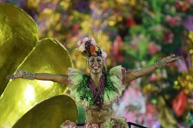 A performer from the Mangueira samba school parades during Carnival celebrations at the Sambadrome in Rio de Janeiro, Brazil, Monday, Feb. 16, 2015. (AP Photo/Felipe Dana)
