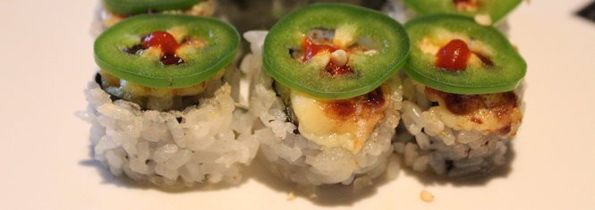 The Dragon's Breath Roll topped with jalapenos and sriracha.