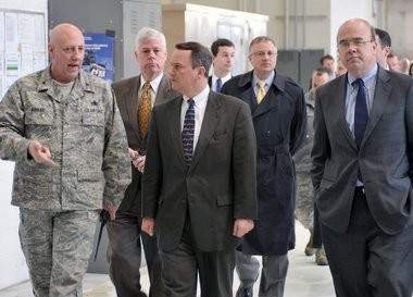 Col. Kerry L. Kohler, commander of the 439th Maintenance Group, Air Force Reserve Command, Westover Air Reserve Base, leads a tour of a maintenance facility on the base for a group trying to save the base from cuts last year including Lt. Gov. Timothy Murphy, center, Richard K. Sullivan Jr. Secretary, Executive Office of Energy and Environmental Affairs, second from left, and U.S. rep. James McGovern, 3rd Congressional District, right.