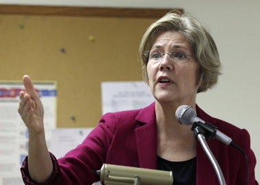 Democrat Elizabeth Warren gestures as she campaigns for the U.S. Senate at a senior housing complex in Quincy, Mass., Tuesday Oct. 16, 2012. (AP Photo/Charles Krupa)