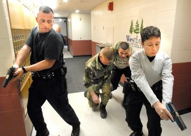 Police conduct a training exercise at Westfield State University in this 2008 photo. The guns they are using are partly marked in blue to show they are not real.