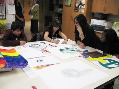 Students at Renaissance Public School work on their Du Bois inspired artwork. From left to right: Korey Collazo, 12, Kassandra Velez, 13, Tracey Nguyen, 13, and Damahya Mongroo, 13.