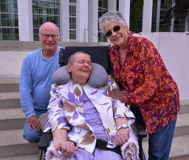 Loretta Rolland of Holden, Mass., center, smiles as she leaves U. S. Federal Court in Springfield Wednesday with her brother Alfred Rolland, left, of Springfield and her sister, Claire Harris, right, of Chicopee. Loretta is the lead plaintiff in a class action lawsuit first filed against the Commonwealth of Massachusetts in 1998 seeking to move mentally and developmentally disabled patients from nursing homes to community based care facilities.