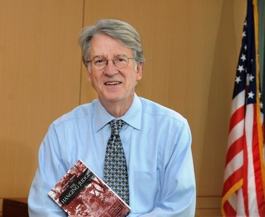 U. S. District Court Judge Michael A. Ponsor with a copy of his new book,The Hanging Judge.
