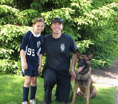 Allison Henry, 10, of Palmer, in a recent meeting with Holyoke Police Officer Matthew Welch and Ryker of the department's canine unit. Allison mounted a campaign to raise money to buy a protective vest for Ryker.