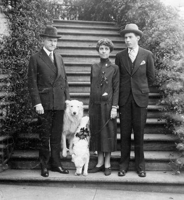 This 1925 photo shows President Calvin Coolidge, his wife, Grace, and their son, John, with the family pets, Rob Roy and Miss Prim.