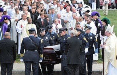 Hampden police carry the casket at the Rev. Paul Archambault's funeral.
