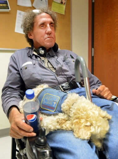 John Giera, 55, of Chicopee, sits in his wheelchair with his service dog, Tabitha, in a break room at the Worthington Street Friends of the Homeless shelter, where has has lived for nearly a year after his hoarding habit forced city officials to banish him from his home.